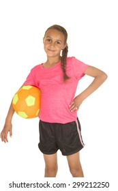 Young girl standing holding soccer ball smiling