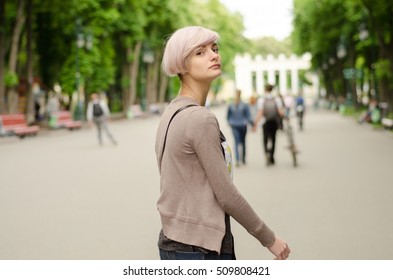 Young girl standing on the road in the park
