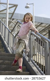 Young girl standing on steps