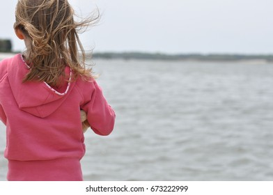 Young girl standing in wind