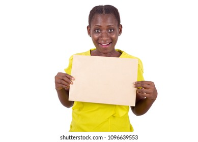 young girl standing in yellow camisole with envelope glued to the chest looks at the camera smiling.