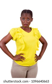 young girl standing in yellow camisole hands on hip looking at camera surprise.