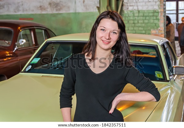 young-girl-stands-smiles-against-600w-18