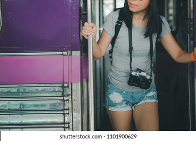 Young girl step down from the train, Summer holiday and travel concept