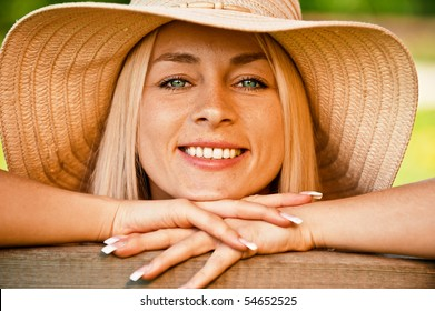 The young girl in straw hat