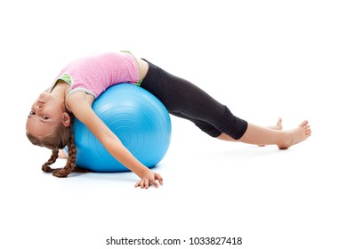 Young girl stretching her back on large gymnastic rubber ball - relaxing after workout, isolated
