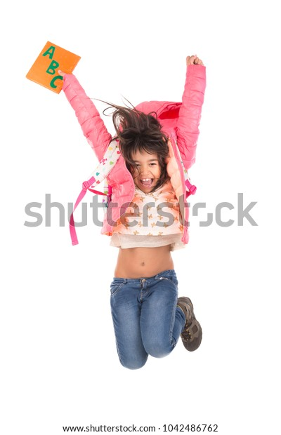 Young girl student jumping isolated in white