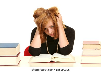 Young girl studying for exams.