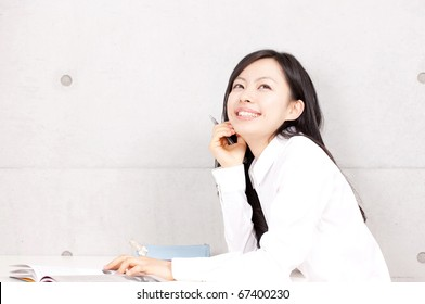 Young girl studying with text book