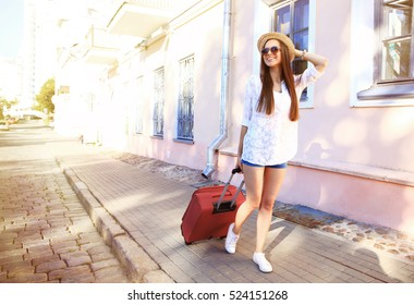 Young girl with a suitcase. Vacation concept