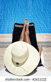 young girl sunbathing at the pool