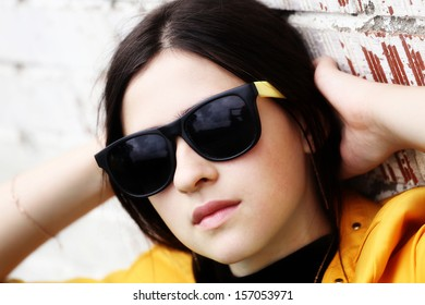 A young girl in sunglasses