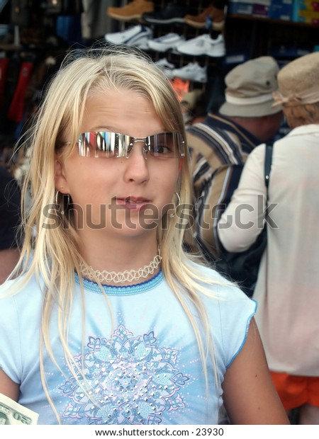 Young girl in sunglasses with that Hey Now! attitude