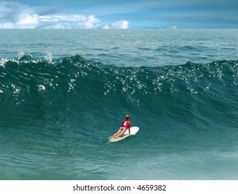 Young girl surfing on Malibu Beach, California