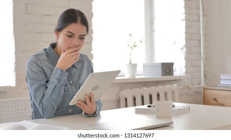 Young Girl Surprised by Results while Using Tablet