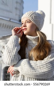 young girl in a sweater and knit hat. Winter portrait