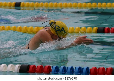 Young girl swimming breast stroke