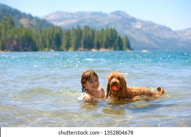 Young Girl Swimming with Dog