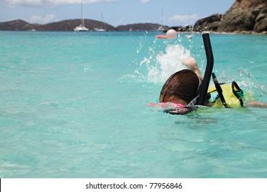 Young girl swims with snorkeling gear, St. John