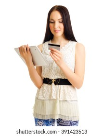 Young girl with tablet PC and credit card isolated