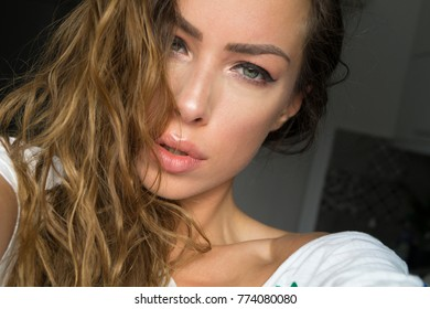 young girl take selfie from hands with phone in bedroom
