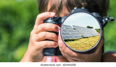 Young girl taking photos of Solar Panels by professional digital camera.