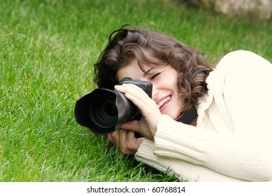 young girl taking picture on natural background