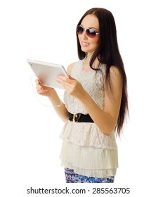 Young girl talking by tablet PC isolated