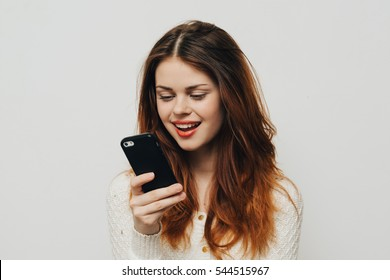 Young girl talking on the smartphone. The girl with a smartphone in the hands of