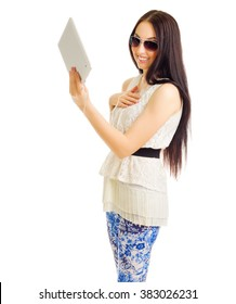 Young girl talks by tablet PC isolated