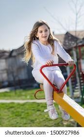 Young girl at teeter at playground