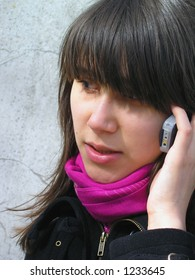 a young girl with a telephonr