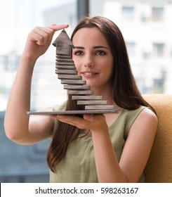 Young girl thinking of career ladder