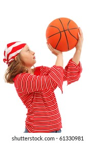 Young girl throwing with basket ball