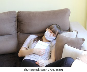 young girl for the time of the covid 19 pandemic and the inability to leave the apartment using her time reading books well   be responsible stay home COVID 19
