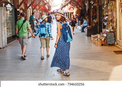 Young girl tourist walking in the old souvenir market in Istanbul, Turkey