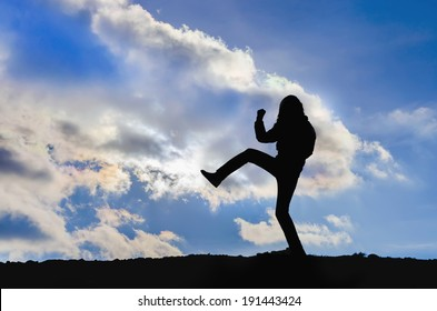 Young girl training karate silhouette