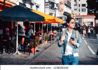 Young girl traveling on Stanley Market in Hong Kong