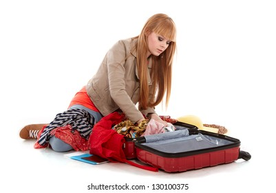 young girl  tries to close her suitcase