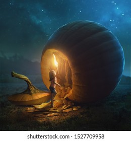 A young girl tries to go inside a very large pumpkin.
