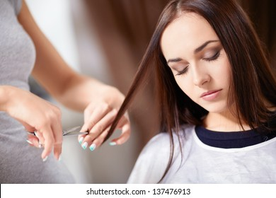Young girl trimmed hair in a beauty salon