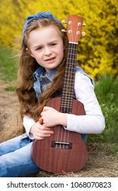 Young girl  with ukulele