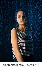 Young Girl Under Drops Water
