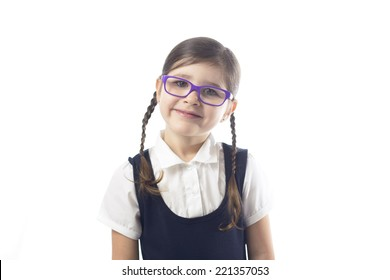 Young girl in uniform ready for her first day of school.