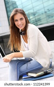 Young girl at university using laptop computer