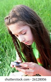 Young girl using cell phone.
