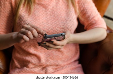 Young girl is using her cell phone