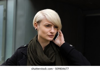 Young girl using her phone in the city