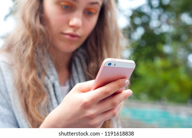 Young girl using a phone