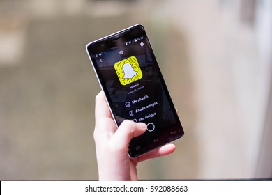 Young girl using snapchat, Snapchat increase it worth in the stock market this month (March).